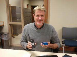 Jeff KE0GKF holding his TYT MD-380 HT and his SharkRF OpenSPOT mini digital repeater.