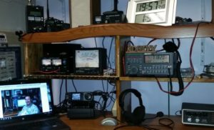 "Chris Skinner KCØIVV writes, ""Here is my ham desk with the IC-7000 for the 144.250 USB net Running a Diamond x300 vertical up about 50'"""