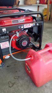 Notice plastic tube draining gasoline